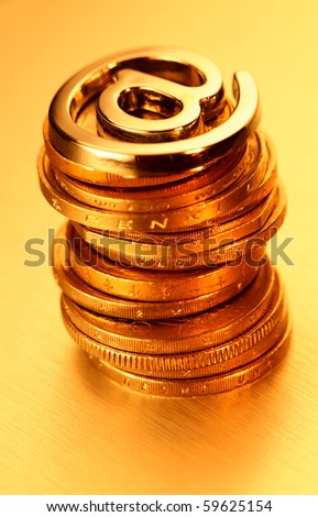 pile of coins & sign the Internet - email - stock photo