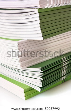 Pile of color magazines isolated on white background - stock photo