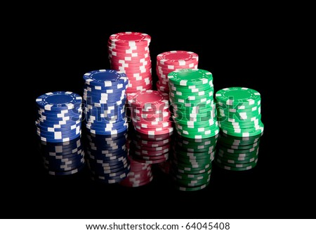 Pile of colored poker chips - stock photo