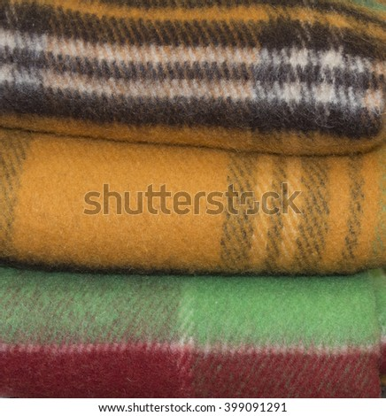 Pile of colored woolen blankets. Close up. - stock photo