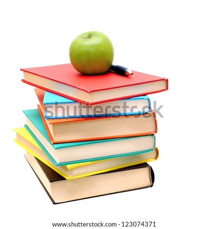 pile of colorful books and apple isolated on white background - stock photo