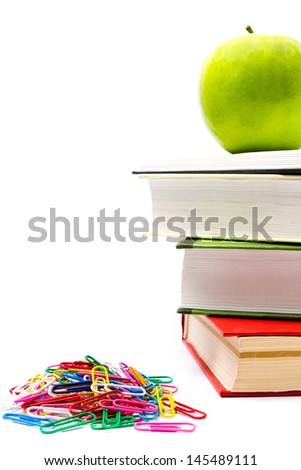 Pile of colorful books and apple on white background. Back to school concept. Closeup - stock photo
