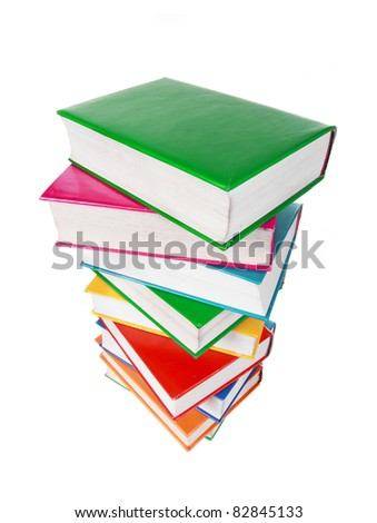 Pile of colorful books isolated on a white background - stock photo