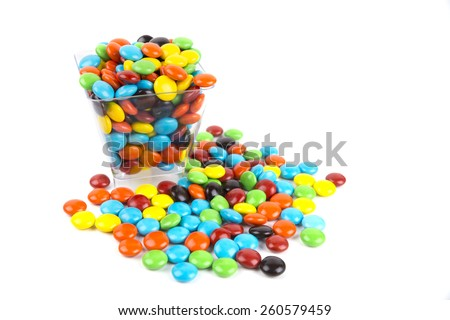 Pile of colorful candy drops isolated on white - stock photo