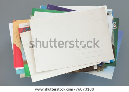 Pile of colorful cards on gray background - stock photo
