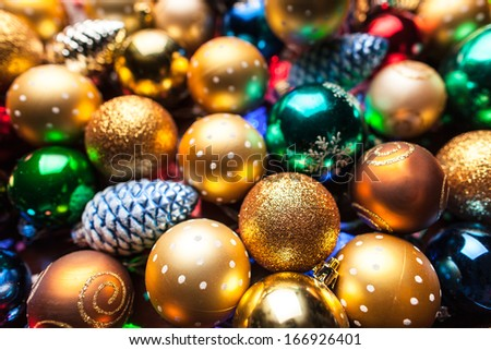 pile of colorful Christmas balls with blurred background - stock photo