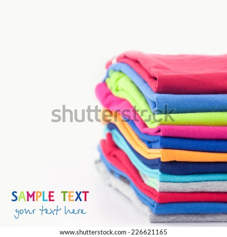 Pile of colorful clothes. - stock photo