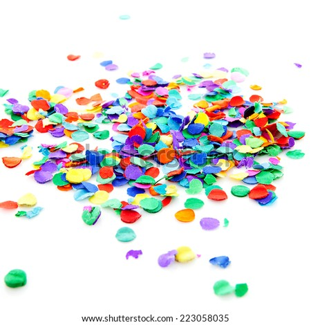 pile of colorful confetti over white background