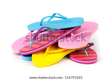 Pile of Colorful Flip Flops Isolated on White - stock photo