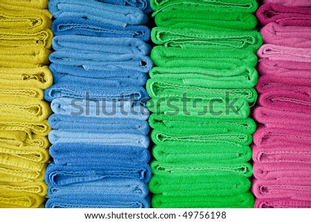 Pile of colorful fresh dry towels. - stock photo