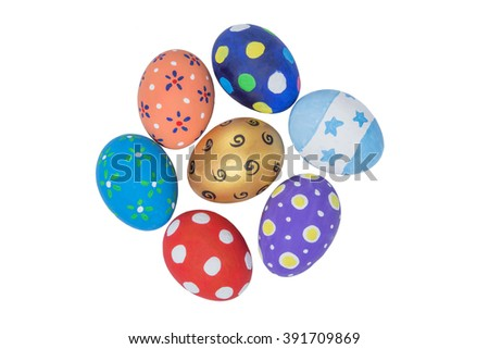 Pile of colorful handmade easter eggs isolated on white Background