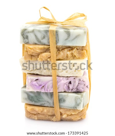 Pile of colorful handmade natural soap tied with ribbon - stock photo