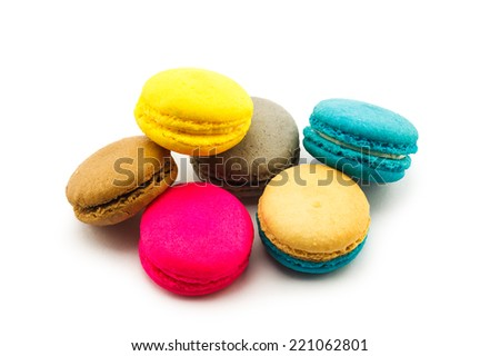 Pile of colorful macaroons on white background