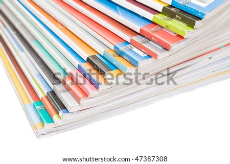 Pile of colorful magazines isolated over white background - stock photo
