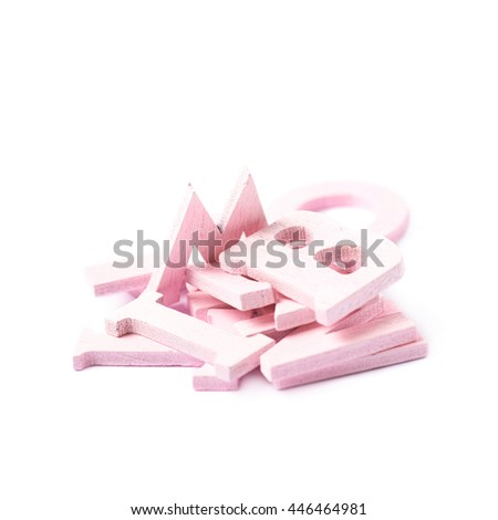 Pile of colorful paint coated wooden letters isolated over the white background - stock photo