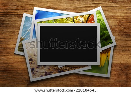 Pile of colorful photos with blank frame - stock photo