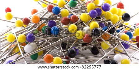 Pile of colorful pins on white background - stock photo