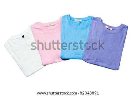 pile of colorful t-shirts freshly folded from the laundry isolated on the white background - stock photo