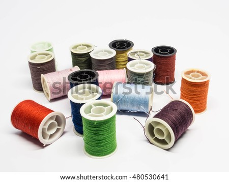 Pile of colorful thread spools for sewing machine