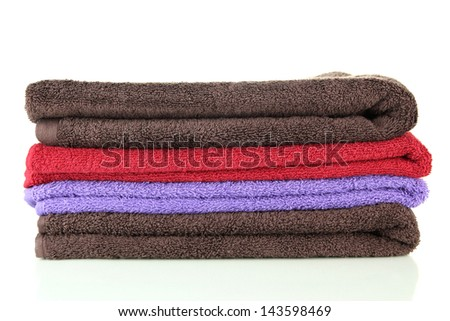 Pile of colorful towels, isolated on white - stock photo