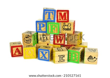 Pile of colorful toy wooden block letters over a white background - stock photo