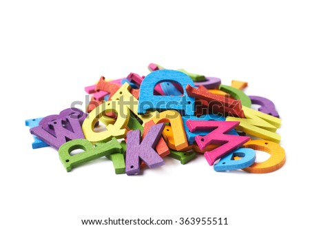 Pile of colorful wooden letters isolated