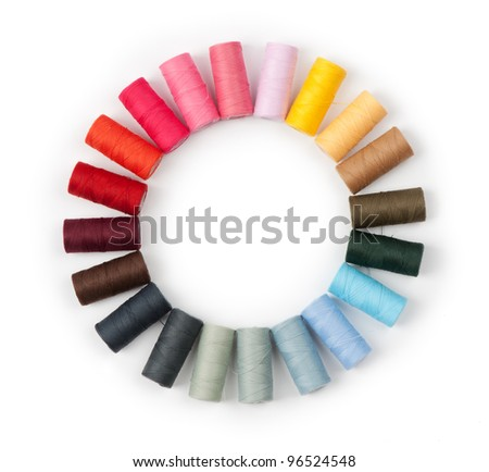 Pile of coloured threads isolated on white - stock photo