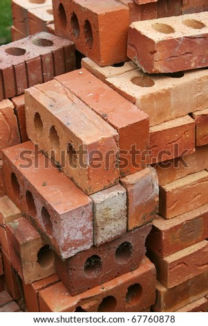 Pile of common building bricks ready for use. - stock photo