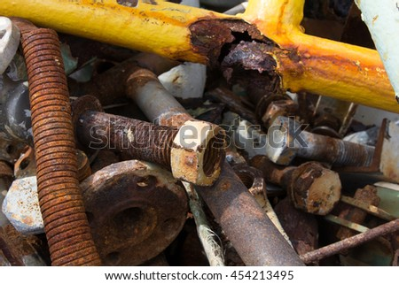 Pile of construction metals in factory. Steel tubes, iron pipes and bars. - stock photo