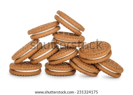 pile of cookies filled with cream isolated on white background - stock photo