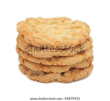 Pile of cookies stacked with nuts, isolated on a white background