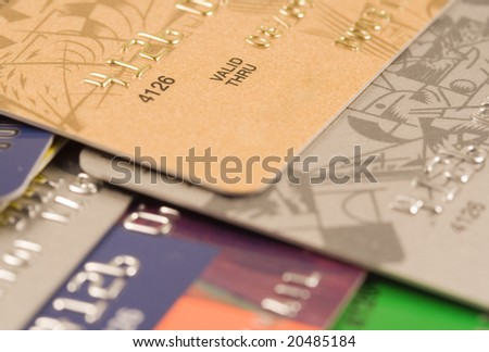 Pile of credit cards. Financial background. Focus on VALID THRU - stock photo