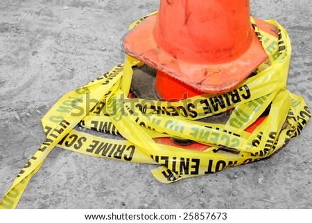 pile of crime scene tape around cone - stock photo
