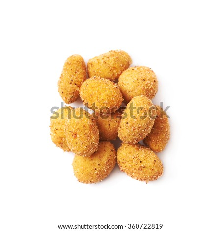Pile of crunchy coated nuts isolated - stock photo