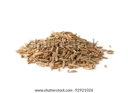 Pile of cumin seeds isolated on white background - stock photo