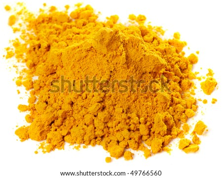 Pile of curry powder isolated on white - stock photo