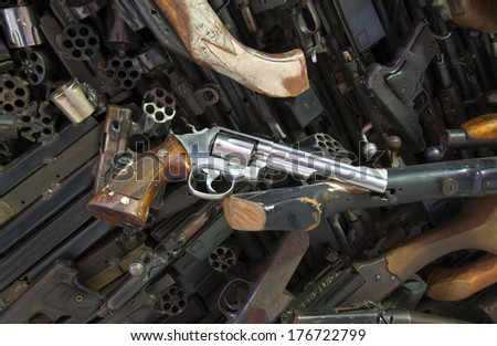 Pile of deactivated weapons - stock photo