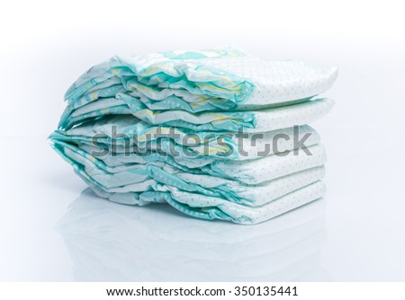 Pile of diapers isolated and reflected on white background