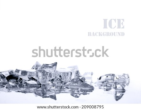 pile of different bright ice cubes on reflection surface on  white background - stock photo