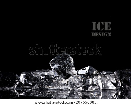 pile of different ice cubes on reflection table on  black background - stock photo