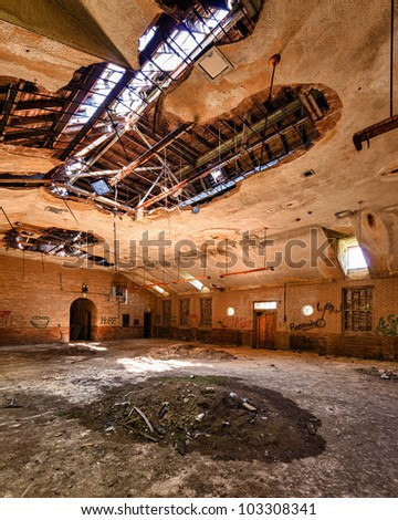 Pile of dirt on floor of an abandoned building from the Manteno State Mental Hospital in Manteno, Illinois - stock photo
