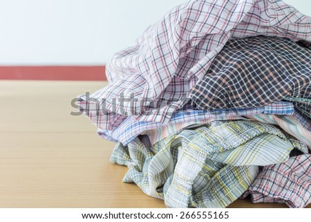 Pile of dirty cloth. Preparing for wash. - stock photo