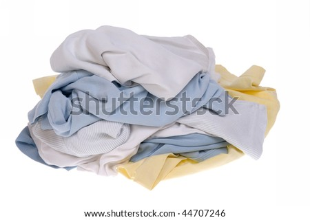 Pile of dirty clothes for the laundry - isolated on white - stock photo