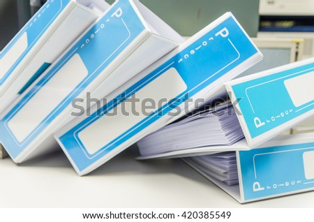 pile of document binder stacked on desk,space - stock photo
