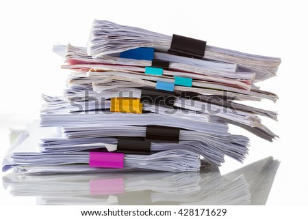 pile of document data file on white background - stock photo