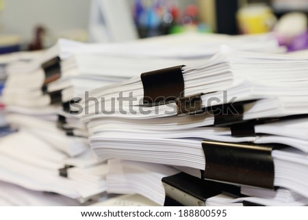 pile of documents on the office desk - stock photo