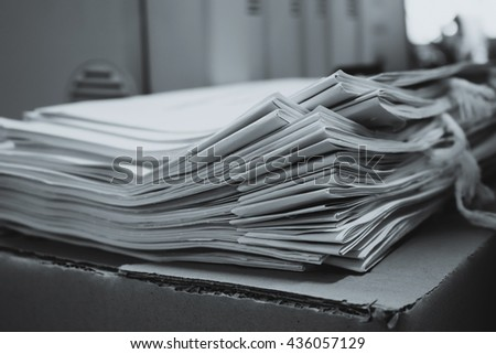 Pile of documents with colorful clips on desk stack up - stock photo