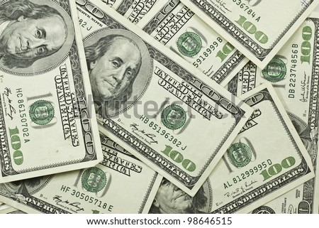 pile of 100 dollar bills background - stock photo