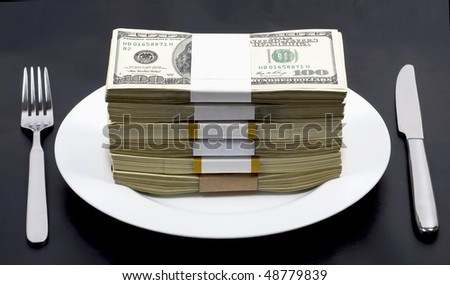 pile of dollar denominations lies on white plate, nearby  knife and  plug