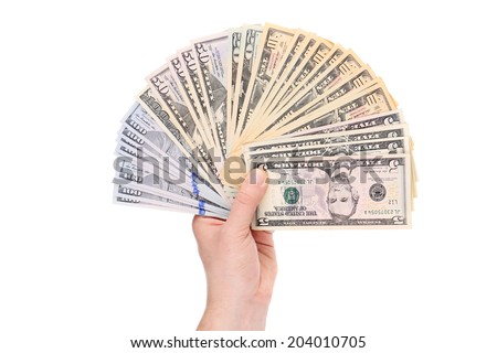 Pile of dollars banknotes in hand. Isolated on a white background.
